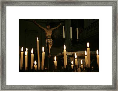 Candles And Saint Inside A Cathedral Framed Print by Gina Martin