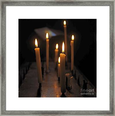 Candles Burning In A Church Framed Print