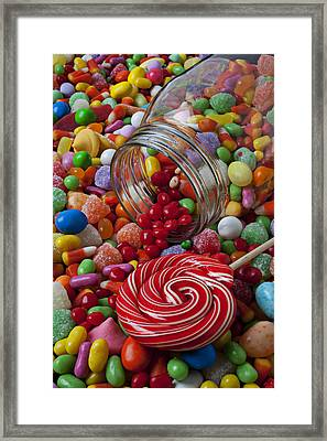 Candy Jar Spilling Candy Framed Print by Garry Gay
