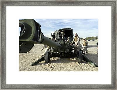 Cannoneers Train With The M777 Framed Print by Stocktrek Images