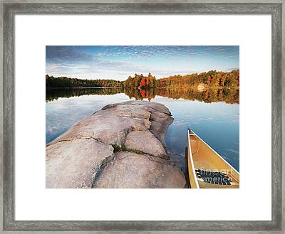 Canoe At A Rocky Shore Autumn Nature Scenery Framed Print by Oleksiy Maksymenko
