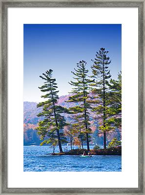 Canoeing On The Lake Framed Print