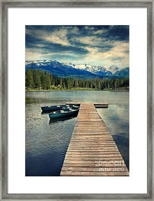 Canoes At Dock On Mountain Lake Framed Print by Jill Battaglia