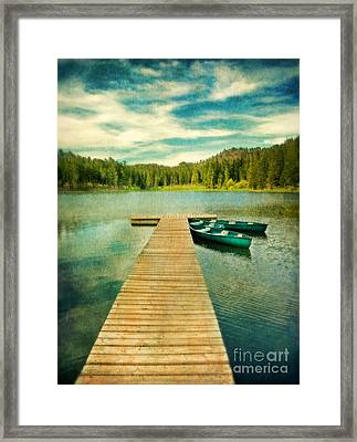 Canoes At The End Of The Dock Framed Print by Jill Battaglia