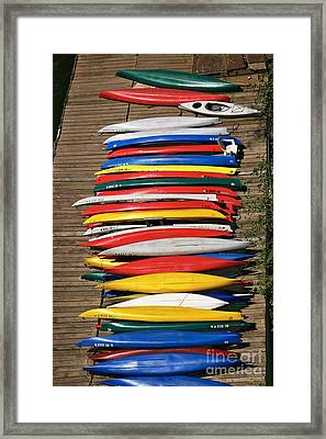 Canoes On A Dock Framed Print by Susan Isakson