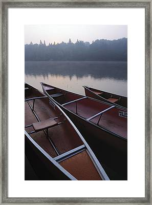 Canoes On Still Water Framed Print by Natural Selection John Reddy