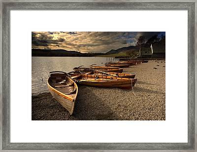 Canoes On The Shore, Keswick, Cumbria Framed Print by John Short