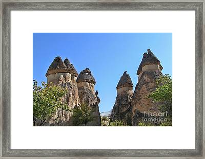 Capped Rock Formations Of Cappadocia Framed Print