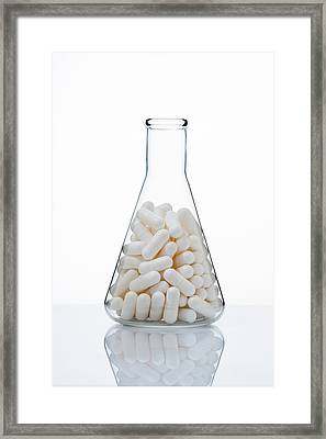 Capsules In Conical Flask Framed Print by Toshiro Shimada