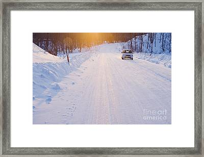 Car On Snow Covered Road Framed Print by Jeremy Woodhouse