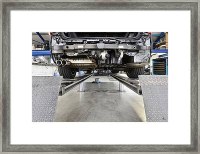 Car Under Repair On A Service Ramp Or Framed Print