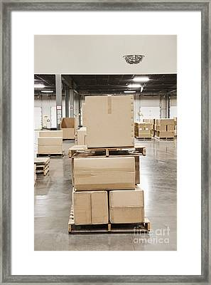 Cardboard Boxes Stacked On Wooden Pallets Framed Print by Jetta Productions, Inc