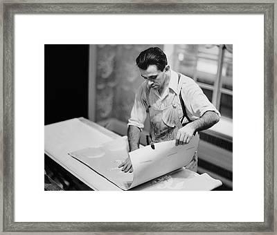 Carpenter Putting On Wallpaper Framed Print