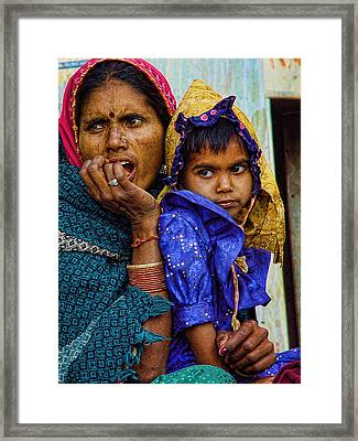 Carrying Hands Framed Print by Ratan Sonal