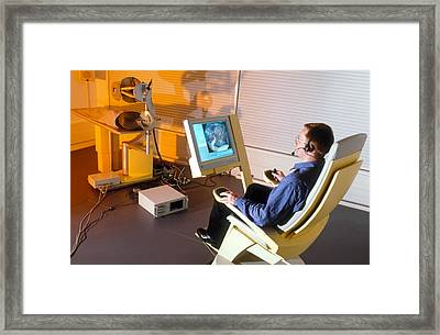 Carrying Out Simulated Robot-aided Brain Surgery Framed Print by Volker Steger