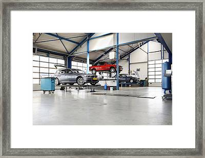 Cars Under Repair On A Service Lift Framed Print