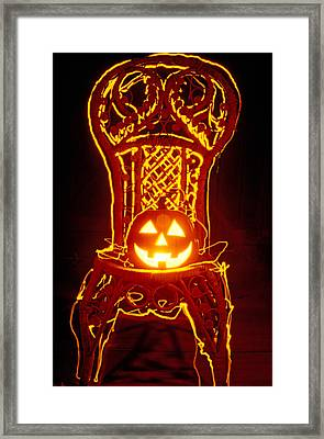 Carved Smiling Pumpkin On Chair Framed Print by Garry Gay