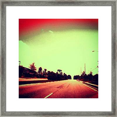 #cary #driving #sky #red #watertower Framed Print