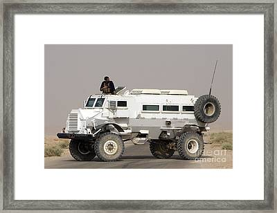 Casper Armored Vehicle Blocks The Road Framed Print by Terry Moore