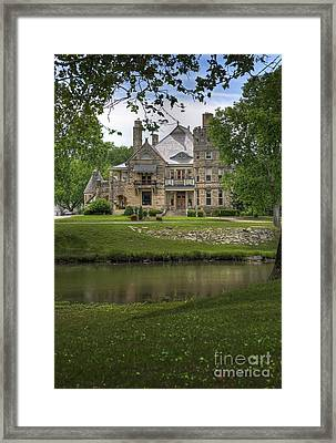 Castle Across River Framed Print by Fred Lassmann