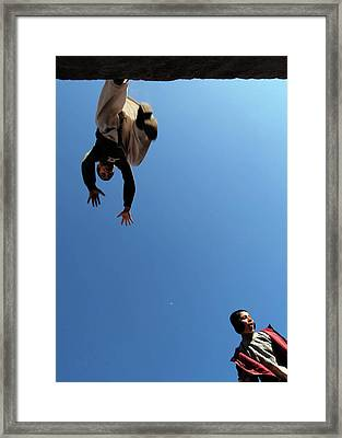 Catch Moon Framed Print