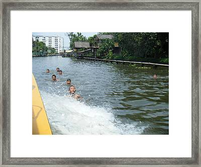Catching A Ride Framed Print