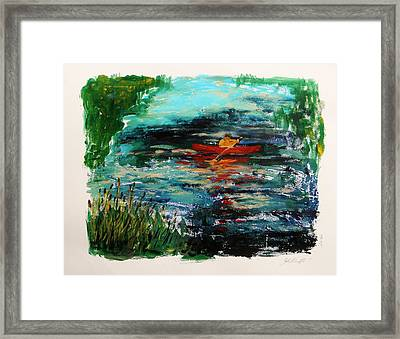 Cattails And Canoe Framed Print by John Williams
