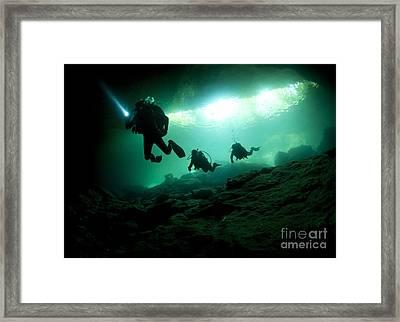 Cavern Divers Enter Cenote System Framed Print