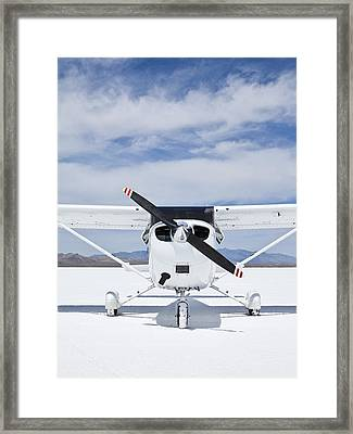 Cessna Aircraft On Bonneville Salt Flats Framed Print by Paul Edmondson