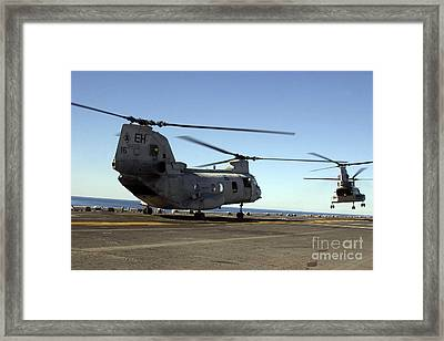 Ch-46e Sea Knight Helicopters Practice Framed Print by Stocktrek Images