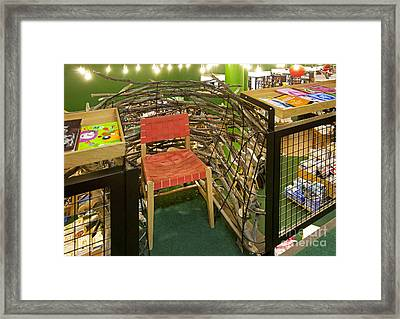 Chair In A Bookstore Framed Print by Jaak Nilson