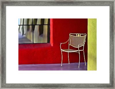 Chair On The Balcony Framed Print by Carol Leigh