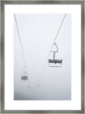 Chairlift In The Fog Framed Print by Matthias Hauser