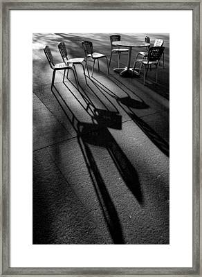 Chairs And Shadows Framed Print