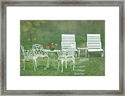 Chairs And Table Set In The Garden. Sun Framed Print by Lawren Lu