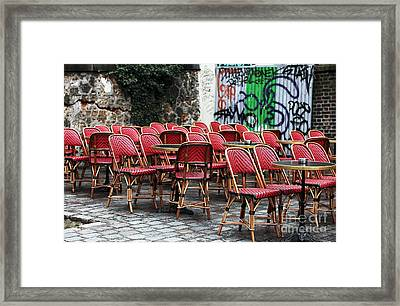 Chaises Rouges Framed Print by John Rizzuto