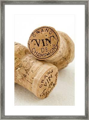 Champagne Corks Framed Print by Frank Tschakert