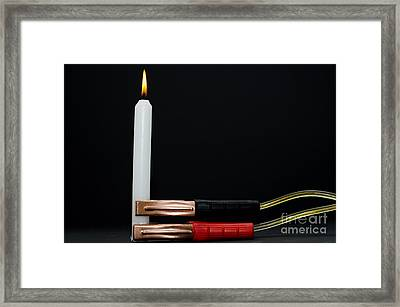 Charging A Candle Framed Print by Mats Silvan