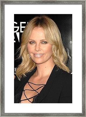 Charlize Theron At Arrivals Framed Print by Everett