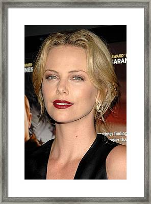 Charlize Theron At Arrivals For In The Framed Print by Everett