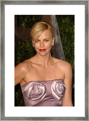 Charlize Theron Wearing A Dior Haute Framed Print by Everett