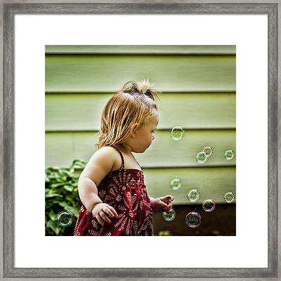 Chasing Bubbles Framed Print by Matt Dobson