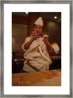 Chef Twirls Dough As He Makes Fresh Framed Print