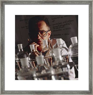 Chemist At Work In His Laboratory Framed Print
