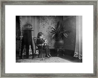 Child Putting A Campbell Kid To Sleep Framed Print by Everett