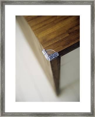 Child Safety: Corner Cushion Framed Print by Ian Boddy