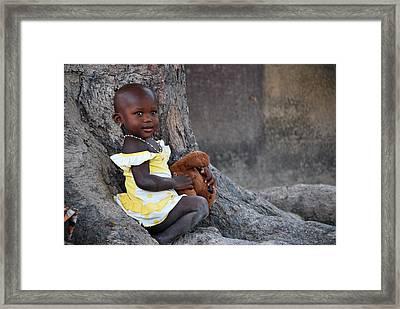 Child With Her Teddy Framed Print by Kamel Rekouane