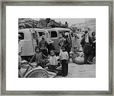 Children And Adults Evacuating Framed Print by Everett