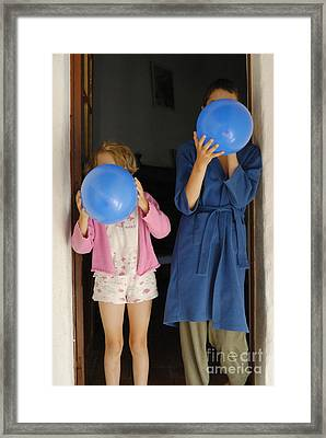 Children Blowing Up Balloons Framed Print by Sami Sarkis