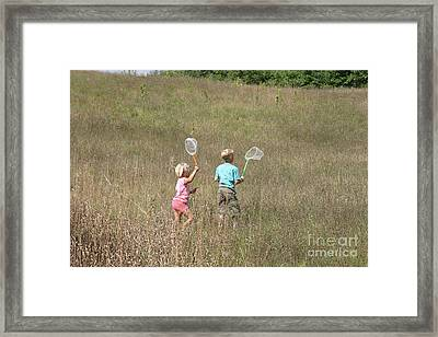 Children Collecting Insects Framed Print by Ted Kinsman